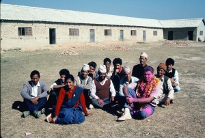 Jeff Gaura sitting with other teachers at Saudiyar School after construction was completed in 1989.