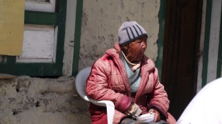 An old Tibetan woman, sitting at a tea shop near the Chinese border in the Khumbu Valley on Nepal.