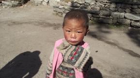 Nepali child wearing a yak wool sweater