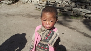 Nepali child wearing a yak wool sweater