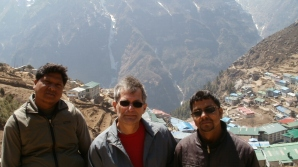 Marty Cocking, Nav Raj and Khopi Ram standing above Namche Bazaar in Nepal